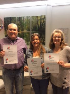 3 volunteers receiving thank you certificates